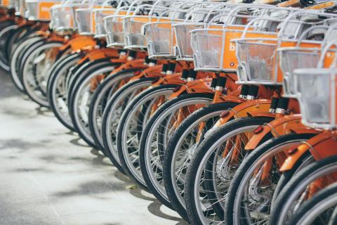 Row of orange bicycles lined up