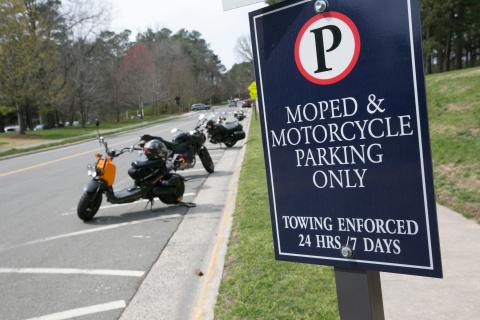 Park your moped or motorcycle in a designated area